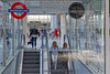 Ups and Downs (Geoff Henson) Tags: station underground escalator steps windows glass signs people transport