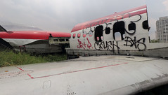 airplane graveyard 65 (_gem_) Tags: trip vacation holiday bangkok thailand airplane airplanes aircraft graveyard airplanegraveyard transportation vehicle graffiti streetart