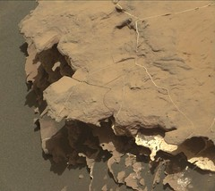 Holes in a Layered Rock (sjrankin) Tags: 21may2018 edited nasa mars msl curiosity galecrater 2052mr0108750010903440e01dxxx rock layers lightcolored holes laserholes sand