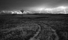 Prairie Thunder (Erik Johnson Photography) Tags: red thunderstorm lightning stormchase stormchasers windmill country road summer weather wx composite stacked long exposure halsey national forest geographic explorer thedford sandhills ecosystem