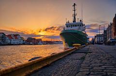 May sunset, Haugesund - Norway (Vest der ute) Tags: xt20 norway rogaland haugesund quay ship houses sea seaside buildings sunset sky clouds city cityscape rocks car fav25 fav200