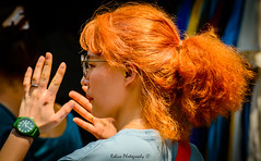 13.31 in orange (Robica Photography) Tags: thailand bangkok daytime daylight sunny hair orange glasses woman lady female asian watch hands closeup d3200 portrait streetphotography robicaphotography art streetart