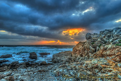 Hands of God (Grasping the Sun) (Michael F. Nyiri) Tags: pebblebeach sunset clouds cloudscapes sky rocks rockyshore california northerncalifornia