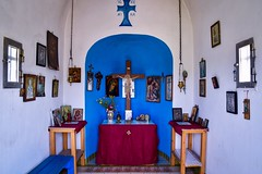 The Greek Cross (rustyruth1959) Tags: virginmary mary images cloth vase flowers altar greek figures interior incenseburners arch painting jesuschristconquers icxcnika crucifiction christ table pictures icons greekcross cross placeofworship churchinterior religiousbuilding church capekefali arillas ionianislands corfu greece europe tamron16300mm nikond5600 nikon bench wall tiles floor window glass chains