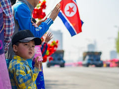 Watching the military parade in Pyongyang, DPRK (TeunJanssen) Tags: dprk asia northkorea pyongyang flag parade waving tanks military ypt youngpioneertours korea olympus omd omdem10 backpacking travel traveling worldtravel worldtrip people celebration kimilsung dayofthesun anniversary 45mm