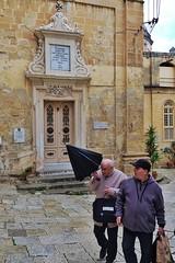 Malta Streets (Douguerreotype) Tags: church candid city people buildings street uk umbrella malta architecture urban door