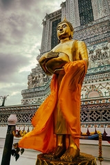 Statue of Buddha in the wind at the entrance of the Wat Arun buddhist temple (Davide Seddio) Tags: thailand architecture bangkok buddhism buildingexterior capitalcities colorimage day eastasianculture famousplace nopeople outdoors photography religion sculpture spirituality templebuilding thaiculture thepast tourism tourist tradition traveldestinations vacations wat watarun