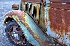 Ford Fender_187312 (rjmonner) Tags: ford truck antique relic rusted dilapidated patina broken fender hood vents bent red blue idaho door hinge mirror headlight art curves tire wheel