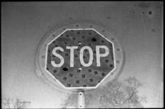 Stop x Manhole (MarekSokal) Tags: canon canonfd 50mm14ssc mareksokal winnipeg doubleexposure 35mmfilm bw blackandwhite canona1 rodinal ilford fp4