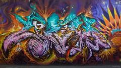 IMGP9803 Monsters (Claudio e Lucia Images around the world) Tags: murales graffiti streetart milano vialemonza ferrovia via pontano milanese pentax pentaxk3ii sigma sigma1020 pittura face faccia murale joker green smile muro