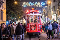 Red trolley car carries passengers through the busy city streets of Istanbul, Turkey (Remsberg Photos) Tags: istanbul turkey city urban night illuminated trolley transportation train railway metropolitan street middleeast trolly streetcar crowded busy transporation passenger citylife nightlife bustling lively