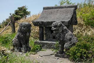 small stone shrine and komainu