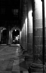 Through the night (Gabo Barreto) Tags: bilbao paisvasco basquecountry spain columns light night grain arches film 35mm 135 blackandwhite filmisnotdead trix selfdeveloped scannedfromfilm pushprocessing canon a1 fd monochrome analoguephotography plazanueva