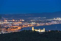 Castle blue hour (David S.M.) Tags: bellver castle castillo palma mallorca baleares night bluehour sonya7ii blue sea forest trees lights travel
