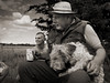 Tony with his dog (paul indigo) Tags: paulindigo portfolio dog tea blackandwhite traveler hat