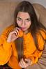 Orange (piotr_szymanek) Tags: kornelia korneliaw portrait studio woman milf young skinny orange longhair eyesoncamera face sofa 1k 20f 5k closeup
