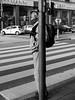 Stripes (Janka Takács Sipos) Tags: street calle utca ulica streetphoto streetphotography photography callejera fotografiacallejera utcafotó poulicnafotografia bnw black white blackandwhite monochrome fuji fujifilm xseries x20 fujux20 candid unposed crossing zebracrossing concrete man oldman elderly lamppost stripe stripes urban road sign car hat backpack