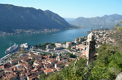 View from the Castle at Kotor, Montenegro (CRAddison) Tags: kotor bayofkotor montenegro monastery church tower cruise ship bay water valley mountainside hill hillside walls city medieval castle dome port harbour lake mountain sea sky landscape town old wall walled boat liner building
