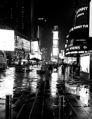 Times Square Night Rain 2 (MassiveKontent) Tags: streetphotography bwphotography streetshot architecture geometric lines symmetry building bw contrast city monochrome urban blackandwhite streetphoto manhattan shadows nyc newyorkcity walkway street road newyorkstreet newyorkcitystreet newyork midtown metropolis metropolitan america cityscape timessquare cityatnight nightlights