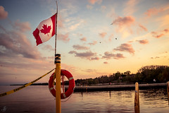 Canadian Waters (Stefen Acepcion) Tags: canada water coast guard lake ontario oakville sky blue golden new afternoon spring clouds beautiful yellow flag nation harbour harbor