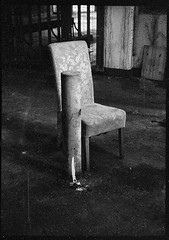chair in a pool of light, Catford multistorey carpark (dmc101) Tags: subminiature grain urban city carpark chair lewisham derelict abandoned noir unexplained tmax100 kodak homedeveloped ilfordddx monochrome blackandwhite 16mm film minolta16 documentaryphotography