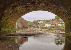 Tunnel Vision (jack cousin) Tags: sandsend yorkshire england uk river stream water shallow rock rocks stone stones riverbank cottage window door fence path wall trees shrub bush foliage grass roof redroof redtiles chimney village hamlet sky cloud tranquilscene hill brick arch bridge oval curved curve shingle pebbles sand under underneath nikond610 on1photos whitby
