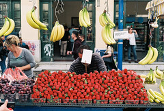 flying bananas and others (Giorgos Voulgaris) Tags: nikonem film 135mm fuji fujicolor c200 candid color analog athens fruits people seller bananas strawberry