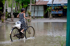 Burmese girl riding bicycle in flood area (cgoering) Tags: area asia asian background beautiful beauty bicycle bike burma burmese childhood city cute cycle cycling disaster environment face flood girl kid kids leisure lifestyle little mandalay myanmar natural nature people person portrait rain raining ride riding road street tradition traditional transportation urban water weather wet woman young female child spring thailand pdc