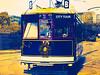 B on the City Tour (Steve Taylor (Photography)) Tags: digitalart building purple yellow red weird man newzealand nz southisland canterbury christchurch cbd city 15 b rail tour tram wreath texture lines vehicle