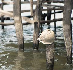 img132 (deepchi1) Tags: irian jaya west papua irianjaya westpapua indonesia stoneagepeople island jungle primitive wwiiattifacts ww ii wwii worldwarii helmet