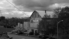 Downtown storm clouds (davekrovetz) Tags: clouds fuji monochrome sky skyline city barn x100s