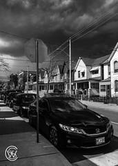 passingBy.jpg (christophersears94) Tags: toronto urban storm littleportugal iphonese blackandwhite canada sky monochrome ontario clouds ca