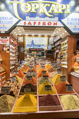 Exterior of storefront at Istanbul Spice bazaar in Turkey with copious bins full of colorful spices on display for sale (Remsberg Photos) Tags: bazaar market souk spice istanbul turkey egyptianbazaar commerce business retail shopping exchange commodities vendor forsale marketplace indoor storefront standing food freshness products saffron eminonuquarter fatihdistrict middleeast consumerism economy