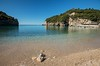 Corfu. Paleokastritsa (Сергей Рсавин) Tags: sand cliff sea rock beach water bay sky ocean landscape mountain forest tree coast shore grass hill photo corfu paleokastritsa