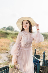 DSC_0161 (tungson.nguyen) Tags: girl woman vietnamese hat backlit dress film portrait sunshine grass