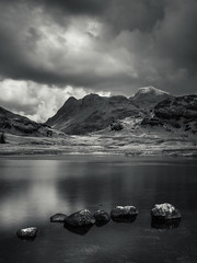 Blea tarn (Ade G) Tags: bw landscape rocks weather clouds lakes mountains reflections tarn water