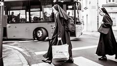 crossing safety (Gerard Koopen) Tags: spanje spain santiagodecompostella nuns walking crossing people vinci bus straat street straatfotografie streetphotography blackandwhite blackandwhiteonly fujifilm fuji x100t 2017 gerardkoopen gerardkoopenphotography streetlife
