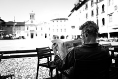 Morning time (Giulio Magnifico) Tags: streetphotography streetlife 28mm citylife portait udine street urbanlife friuli city moment oldcity naturallight film italy news newspaper blackandwhite architecture candid leicaq urban ancient friulano book soulful leica