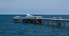 the blue pier (paul hitchmough photography 2) Tags: paulhitchmoughphotography nikond4s nikonphotograhy llanddudno pierhead water ocean rocks northwales coastline windfarm seascape 50mm nifftiyfitty
