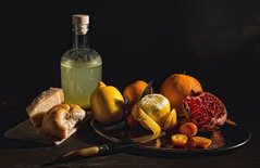Still life with fruits (Rita Eberle-Wessner) Tags: stilllife stillleben früchte fruits zitrusfrüchte lemons zotronen orangen oranges cheese käse brot bread liquor likör food