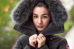 Julia [Stranger #75/100] (Vijay Britto Photography) Tags: green jacket nikon d750 85mm strangers 100strangers outdoorportraits naturallight 18 beautifullady bokeh