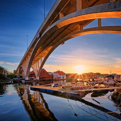 Haugesund, Norway (Vest der ute) Tags: xt2 norway rogaland haugesund bridge boat boats boathouse sunset sky sunstar reflections houses spring sea quay fav25