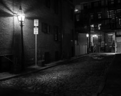 Bay Village Back Alley (with street light illumination) (iMatthew) Tags: bayvillage boston night bw blackandwhite monochromatic illumination alley cobblestone streetlight urban contrast olympuspen olympuspenf penf