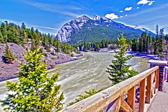 Bow river (begineerphotos) Tags: banff banffnationalpark bowriver bowfalls water river mountain cloud fence tree trees clouds hill explore explored