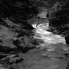 Afon Ystwyth (ss9679) Tags: film ilford panf hasselblad zeiss carlzeiss river wales longexposure nosky blackandwhite dark contrast darktable sonnar epson4180 epson telephoto 150mm f4 cf 500cm analog landscape afon ystwyth kodakhc110 hc110 rocks water monochrome uk wet square 6x6 120 mediumformat mittelformat ceredigion ilfordpanf50 iso50 filmdev:recipe=11917 film:brand=ilford film:name=ilfordpanf50 film:iso=50 developer:brand=kodak developer:name=kodakhc110