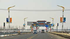 Chinese gate on highway in Harbin, China (phuong.sg@gmail.com) Tags: yunnan ancient architecture asia beauty blue buddhism china chinese color culture decoration dianchi dragon gate green harbin heilongjiang hills holiday jilin kunming lake landscape light morning mountain natural nature park people platform province religion scenery sky taoism tourism travel view viewing water western xishan