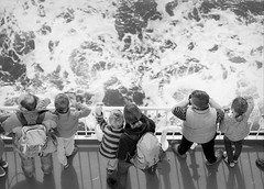 Approaching (p2-r2) Tags: nikon f3 f3hp gothenburg sweden blackandwhite agfa apx 100 new emulsion film sea water ship boat ferry passengers arial shadows