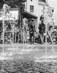Fountainer (A. Yousuf Kurniawan) Tags: fountain water citypark citywalk people streetphotography urbanlife citylife monochrome blackandwhite decisivemoment juxtaposition