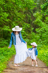 Family Values. Mother and Her Little Daughter Having a Walk In Green Summer Forest.Playing with Dresses  Together. (DmitryMorgan) Tags: 36years 3037years 30s active adorable attractive casualclothes caucasian cheerful child daughter embrace family familyvalues female femininity flash forest happy hug kid leisure lifestyle lighthair longhair mother outdoorshot outdoors portrait positive relaxing smiling strobelight stroll thirties together travelling two walking woman youngadult