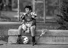 Lacrosse player. (crabsandbeer (Kevin Moore)) Tags: adam baltimore game kids lacrosse maryland people portrait sports disappointment agonyofdefeat bw blackandwhite monochrome environmental loss rainout lax sad emotion candid street